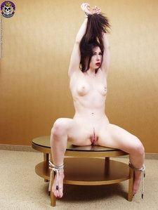 Gorgeous goth girl gets tied to a coffee tablebarelyevil03